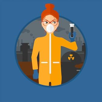 Mulher no terno protetor da radiação com tubo de ensaio.