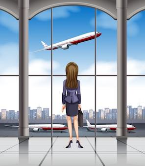 Mulher olhando para o avião decolando