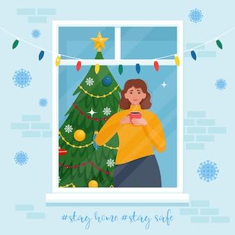 Mulher olhando pela janela e bebe café no feriado de natal. isolamento social durante a pandemia