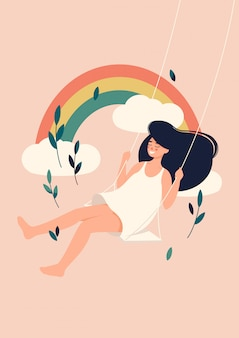 Mulher oscila em um banco de balanço na frente do fundo do arco-íris