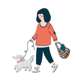 Mulher ou menina com saco de compras passeando com cachorro na trela