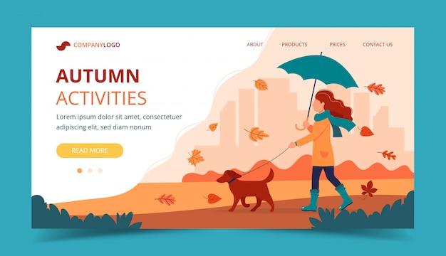 Mulher passeando com um cachorro no outono com guarda-chuva. modelo de página de destino.