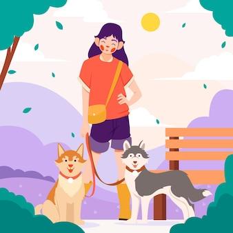Mulher plana com animais de estimação no parque