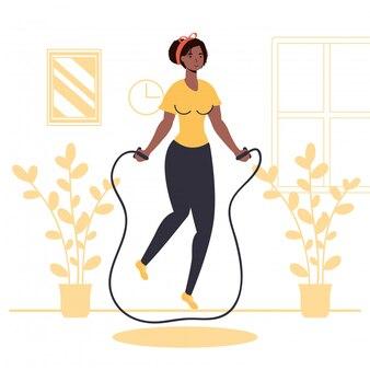 Mulher praticando atividade de esporte de pular corda em casa