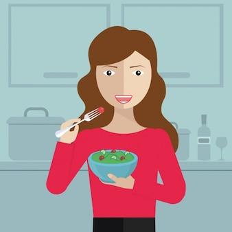 Mulher que come na cozinha