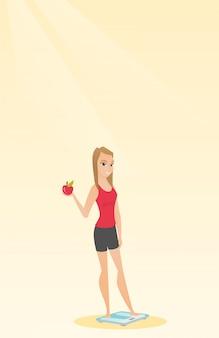 Mulher que está na escala e que mantém a maçã disponivel.