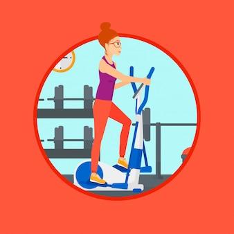 Mulher que exercita no instrutor elíptico