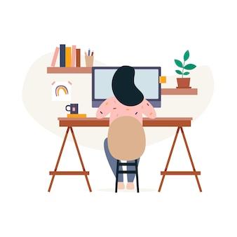 Mulher que trabalha em casa na frente de um monitor