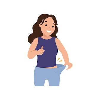Mulher se sentindo feliz por causa de uma dieta bem-sucedida calça solta como resultado da perda de peso.