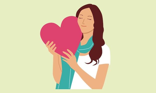 Mulher segura sinal de coração