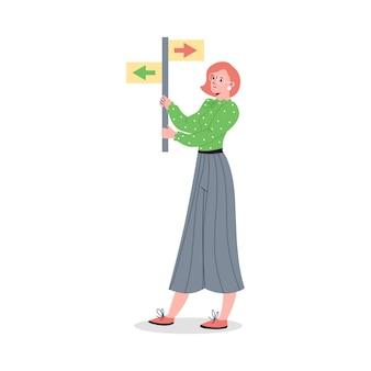 Mulher segurando a ilustração do vetor dos desenhos animados da marca de sinalização de direção isolada