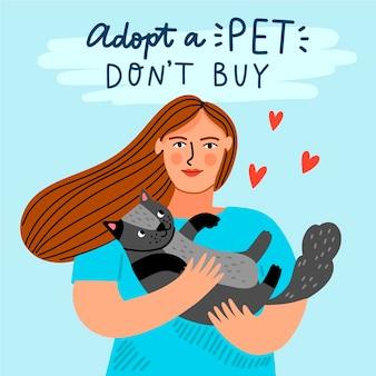 Mulher segurando o animal de estimação adotado