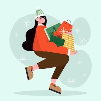 Mulher segurando presentes de natal