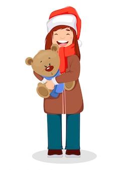 Mulher segurando um urso branco no natal