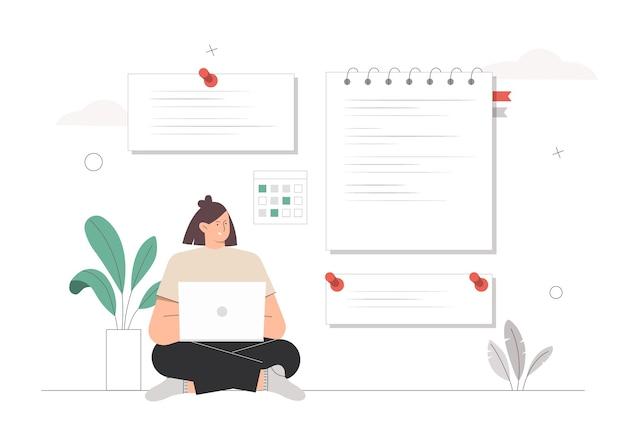 Mulher sentada com um laptop e fazendo anotações