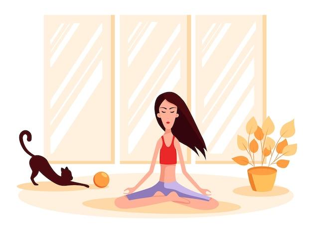 Mulher sentada em posição de lótus, perto dela um gato brinca com uma bola. ilustração dos desenhos animados do vetor de cor. fique em casa.