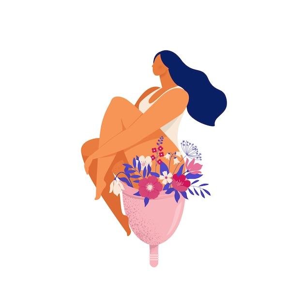 Mulher sentada em um enorme copo menstrual com flores e folhas