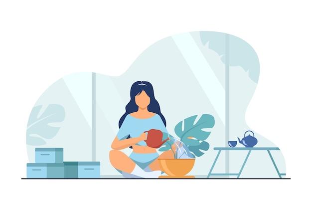 Mulher sentada no chão e regando a planta. casa, água, ilustração em vetor plana folha. conceito de hobby e jardim doméstico