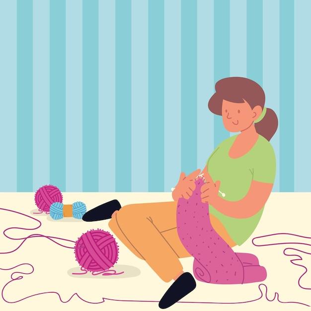 Mulher sentada tecendo cachecol
