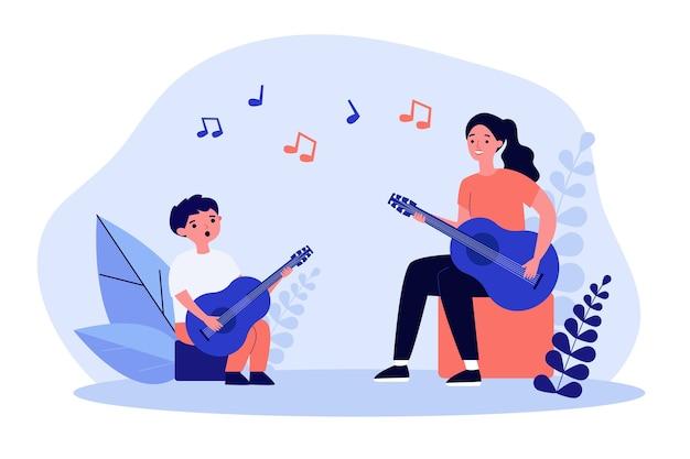 Mulher sorridente tocando violão com o filho