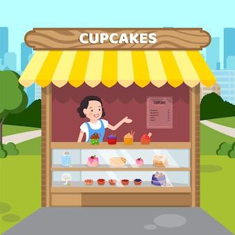 Mulher vendendo cupcakes ilustração vetorial plana