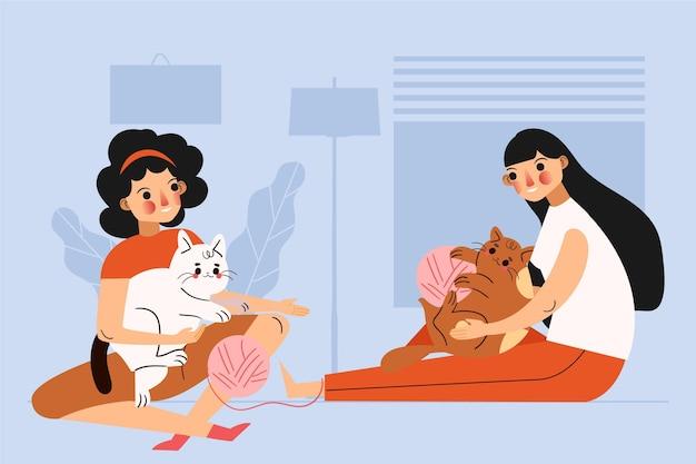 Mulheres brincando junto com seus gatos