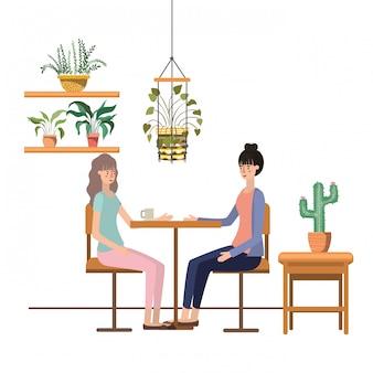 Mulheres, café bebendo, em, a, sala de estar