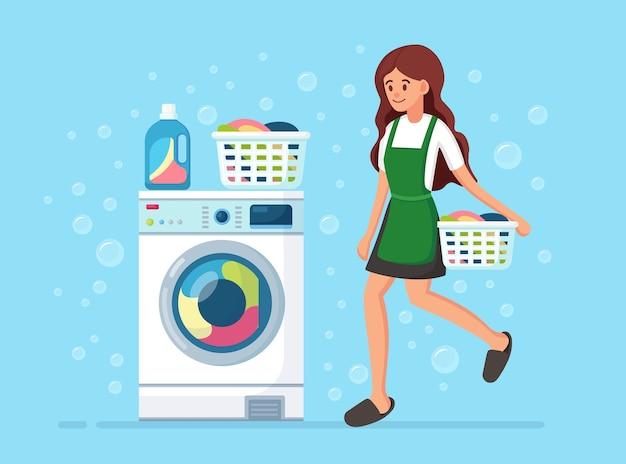 Mulheres com cesto. máquina de lavar com detergente. dona de casa lava com equipamento eletrônico de lavanderia