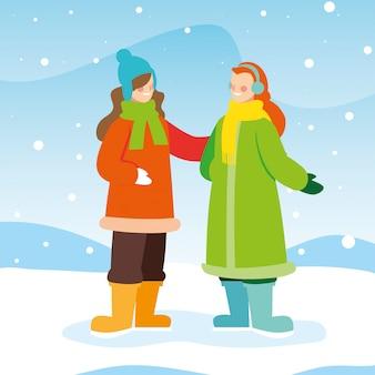 Mulheres com roupas de inverno na paisagem com neve