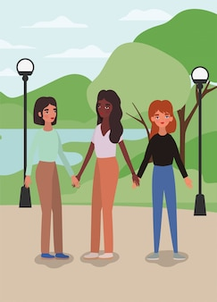 Mulheres de mãos dadas no parque