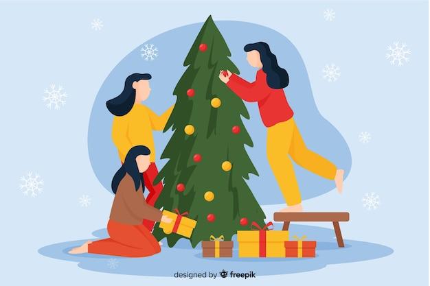 Mulheres decorando a árvore de natal