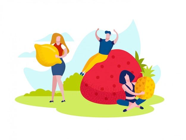 Mulheres e homem com frutas tropicais no jardim.
