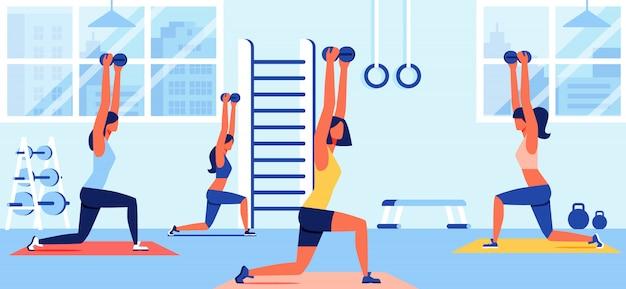 Mulheres, em, sportswear, treinamento, com, dumbbells, em, ginásio