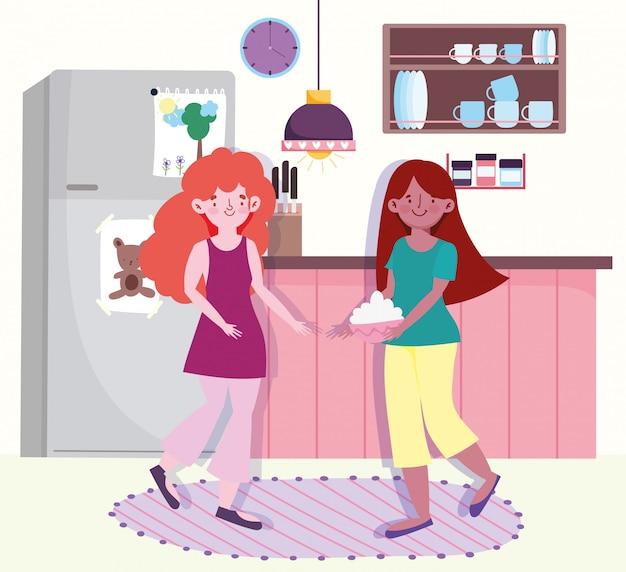 Mulheres fazendo comida com tigela na cozinha