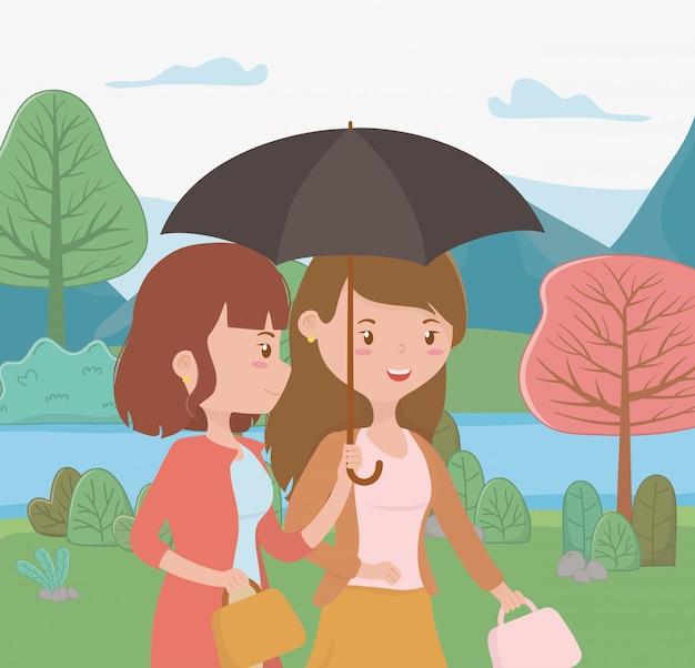 Mulheres jovens, andar, com, guarda-chuva, parque