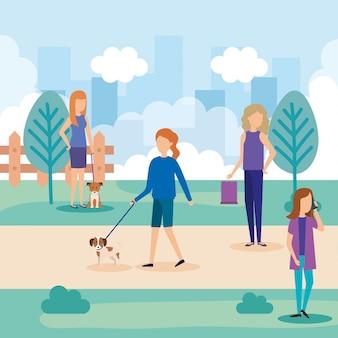 Mulheres jovens com cachorro e sacola de compras no parque