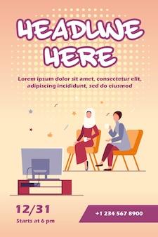 Mulheres muçulmanas sentadas assistindo a um modelo de panfleto na tv