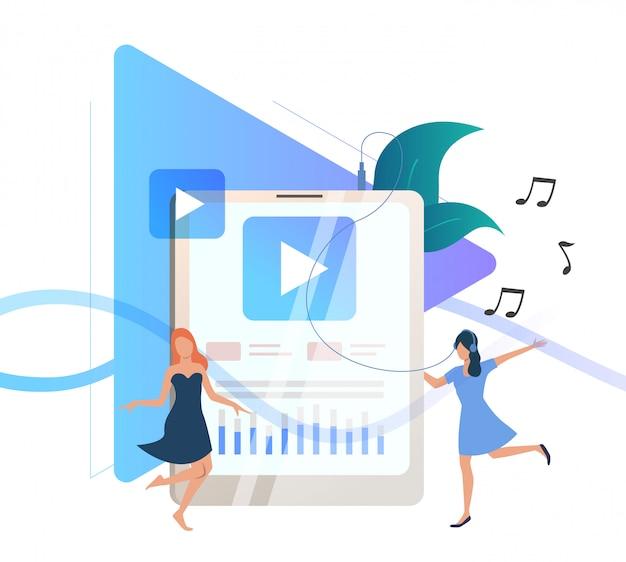 Mulheres ouvindo música no player portátil
