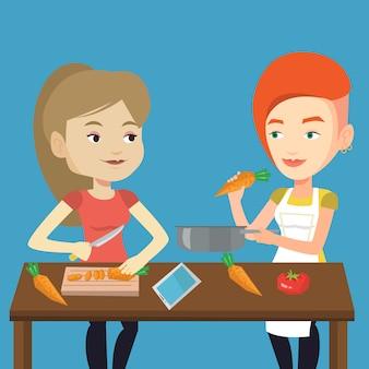 Mulheres que cozinham a refeição vegetal saudável.