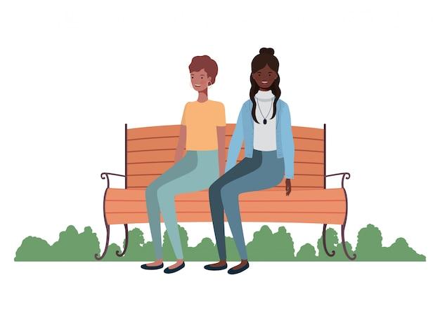 Mulheres, sentando, parque, cadeira, paisagem