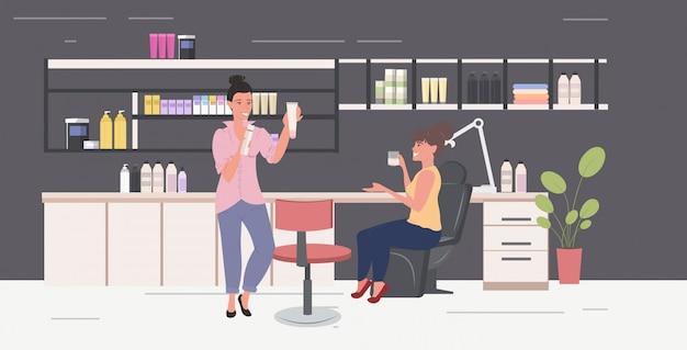 Mulheres teste teste cuidados com a pele produtos cosméticos cosméticos masterclass moderno salão de beleza interior comprimento total horizontal