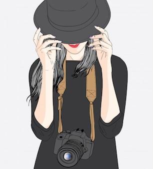Mulheres vestindo chapéus pretos e câmeras