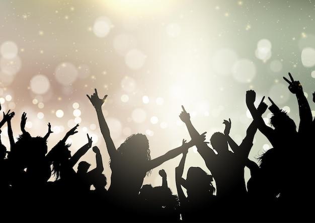 Multidão de festa em um fundo de luzes de bokeh