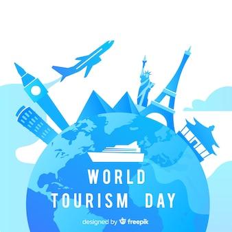 Mundo de dia de turismo de mundo gradiente com marcos Vetor grátis
