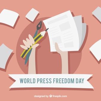 Mundo do fundo do dia da liberdade de imprensa com fólios e lápis