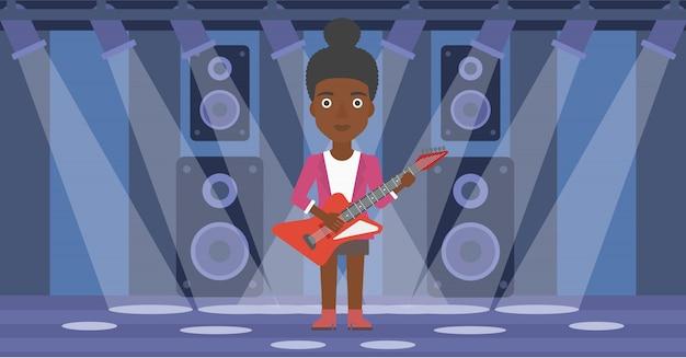 Músico tocando guitarra elétrica.