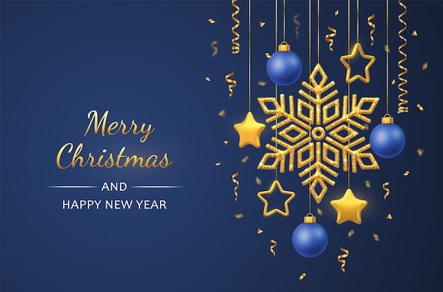 Natal azul com flocos de neve dourados brilhantes pendurados