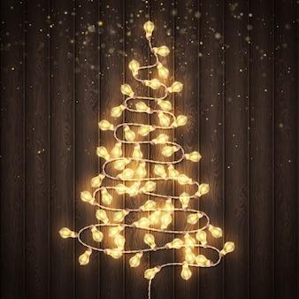 Natal brilhando luzes quentes. fundo de madeira marrom escuro. conceito de cartões de férias de ano novo. e também inclui