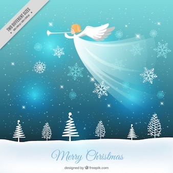 Natal de fundo paisagem de neve e anjo tocando a trombeta