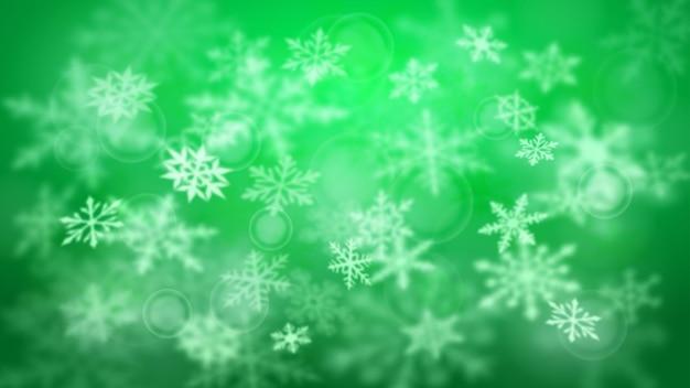 Natal desfocado de fundo desfocado de flocos de neve grandes e pequenos caindo em cores verdes com efeito bokeh